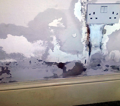 Damp repaired with plaster and filler - not a proper fix.
